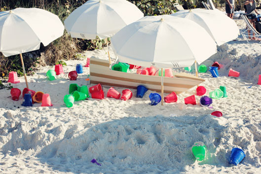 childrens-sand-pails-on-cla