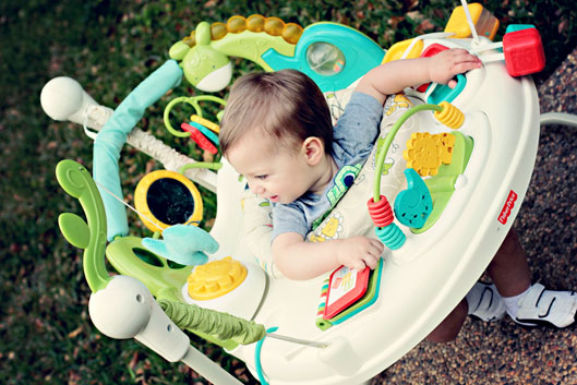 Baby-boy-in-fisher-price-ba