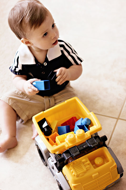 baby-boy-playing-with-dump-