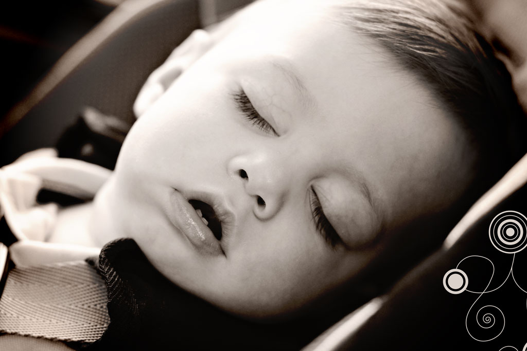 baby-boy-sleeping-car-seat-