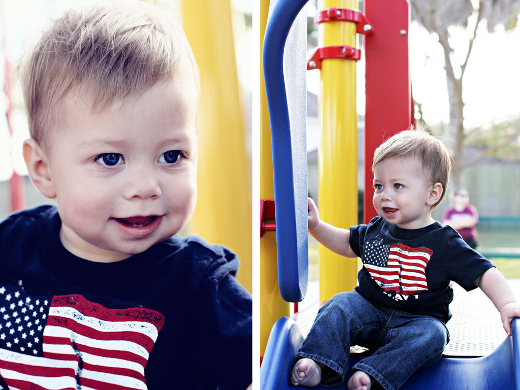 beautiful boy on playground slide