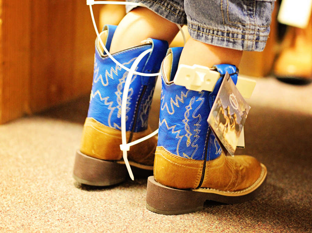 toddler-trying-on-first-cowboy-boots