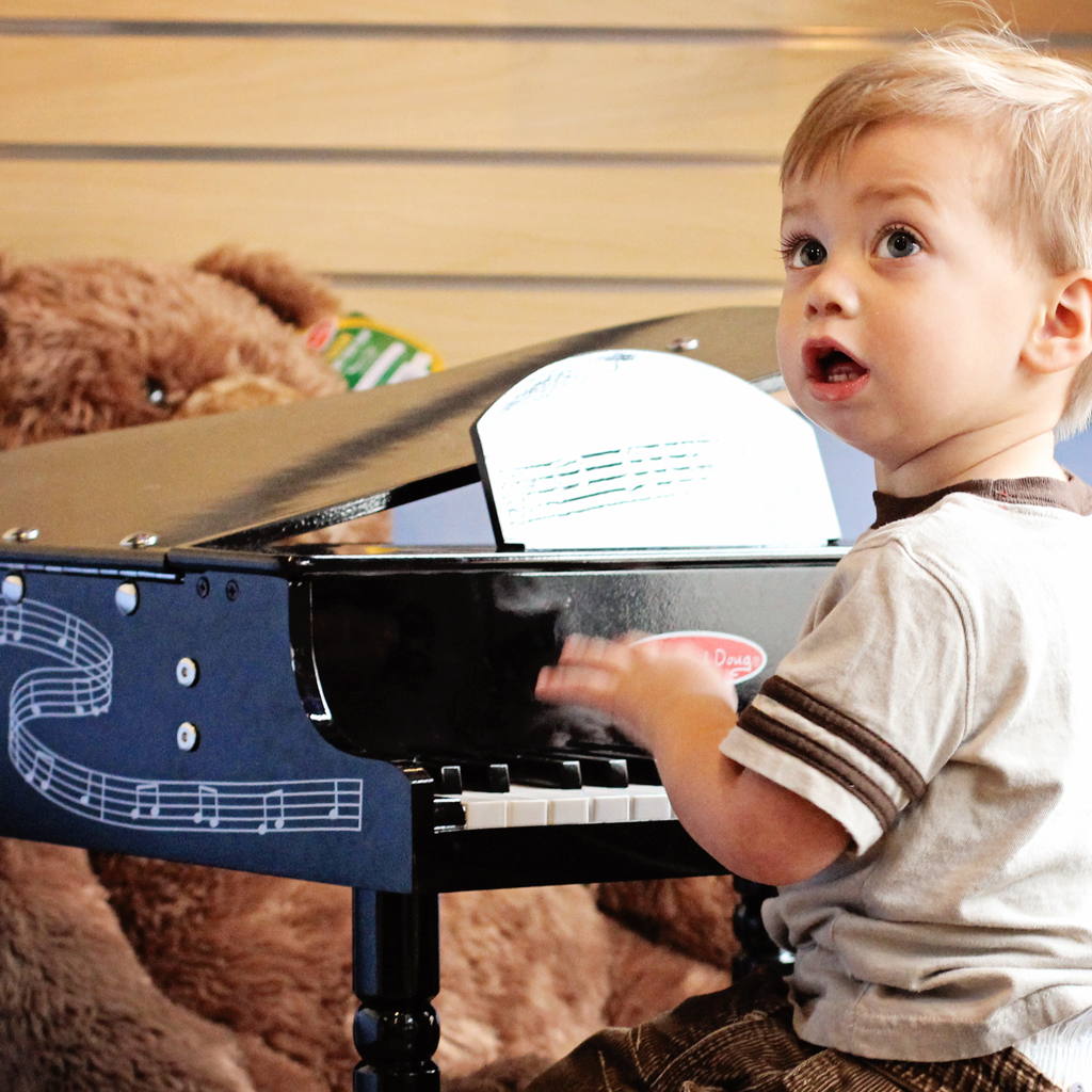 adorable-toddler-playing-childs-piano