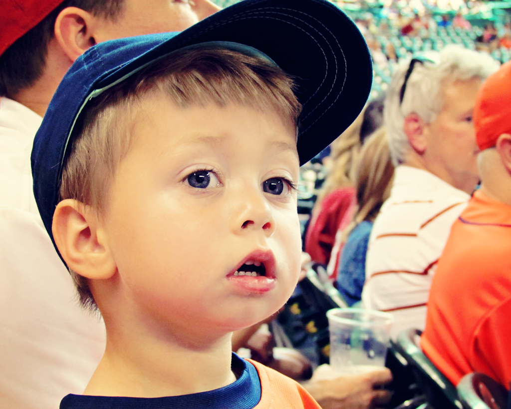 toddler-looking-on-at-astros-baseball-game