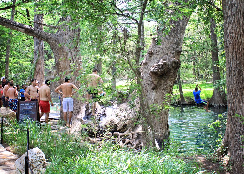 swinging-on-tree-rope-into-creek