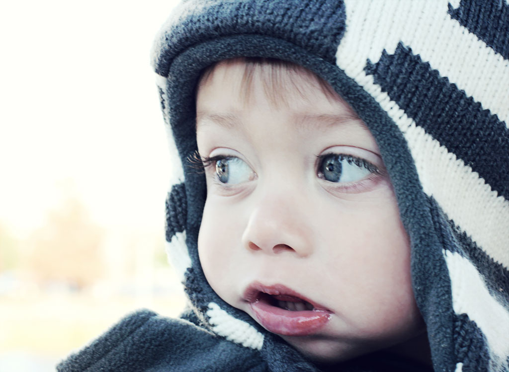 toddler-boy-looking-at-ice-