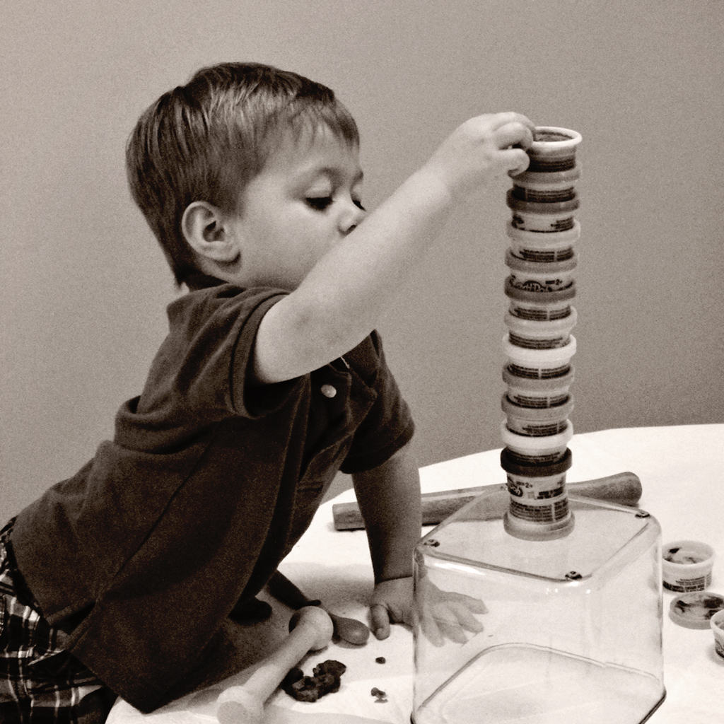 toddler-playing-play-doh-building-tower