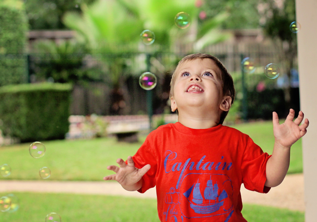 two-year-old-playing-in-bubbles