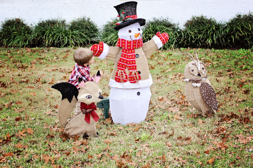 child-with-snowman-at-christmas