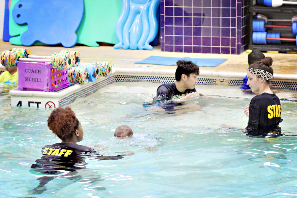 toddler-going-under-water-in-swim-class